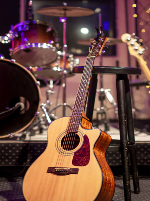 Acoustic guitar on the background of a recording Studio. Room for musicians rehearsals. The concept of musical creativity and show business.