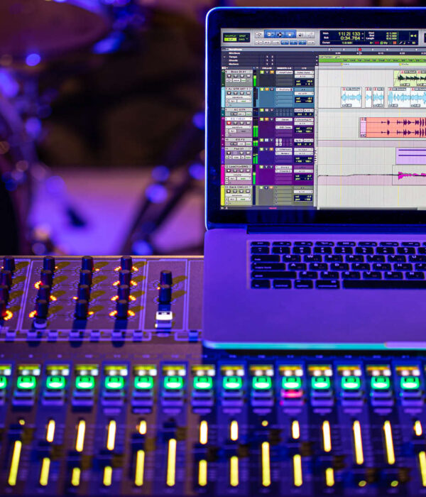 Digital mixer in a recording Studio , with a computer for recording sounds and music. The concept of creativity and show business. Space for text.